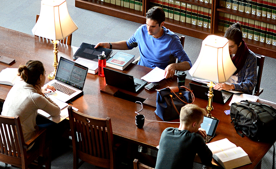 students sitting at table in Law library